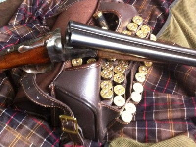 Shotgun, Cartridges and a Cartridge Bag