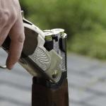 Shotgun broken with two cartridges in the barrels.