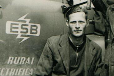 Tim beside the ESB Rural Electrification logo