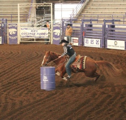 Mikhayla running barrels in Weber Hall at K-State during the 2014 college rodeo. photo by: Amber Thompson