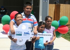 Edith's son, Leixander, and other children celebrate their new homes.