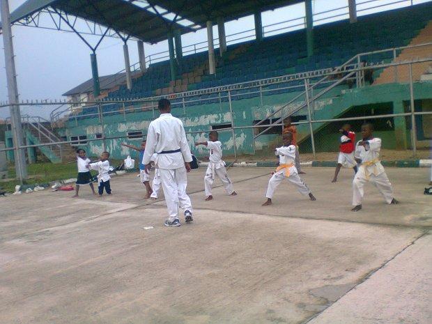 A group of children learning Taekwondo at a stadium in Akwa-Ibom, Nigeria.