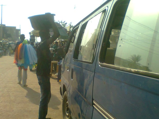 A teenager sells Sachet water to commuters at a motor park in Ogun state, Nigeria.