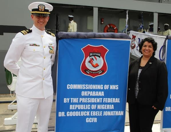 Deputy Chief of Mission, United States Embassy, Abuja, Maria Brewer, (right) with Maritime Affairs Officer, LTCM Sean Hays, during the commissioning ceremony of Nigerian Navy Ship Okpabana  and three other ships by President Goodluck Jonathan in Lagos… on Thursday, February 19, 2015. Photo: U.S. Consulate General, Lagos.