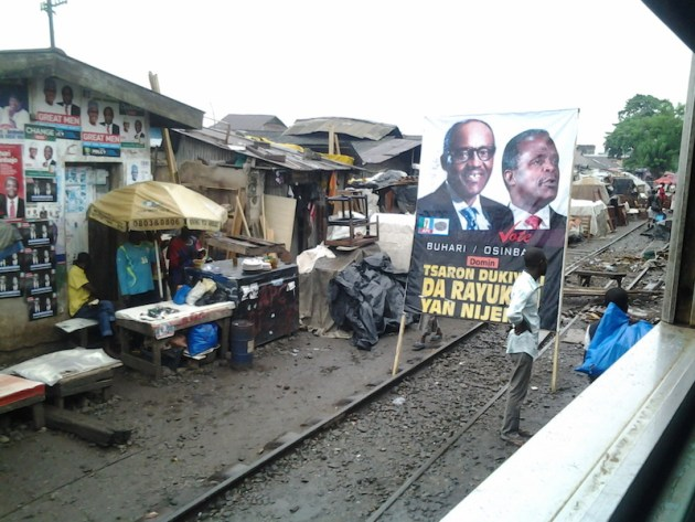 Given the number of people that pass by the railway and on the train daily, the railway serve as a good place for political leaders to canvass for vote. A poster of the newly-elected president and vice-president, Muhammadu Buhari and Yemi Osinbajo is displayed in Hausa community in Agege, Lagos.