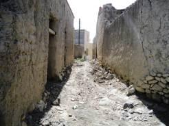 Narrow passage way though the ancient village of Nizar.