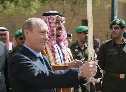 Russian President Putin and Prince Salman bin Abdul Aziz hold swords in Riyadh
