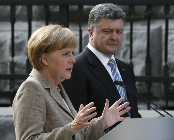 Germany's Chancellor Merkel gestures during a news conference with Ukraine's President Poroshenko in Kiev