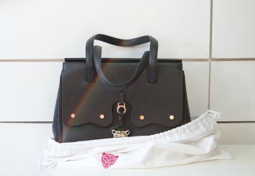black Fiore inside dust bag