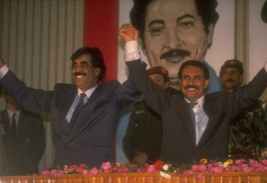 Pres. Ali Abdullah Saleh (L) & VP Ali Salem Al Baidh raising linked hands during ceremony announcing unification of N. & S. Yemen.  (Photo by Thomas Hartwell/The LIFE Images Collection/Getty Images)