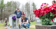 Brandon Bennett, left and his sister Madison, right, watch their mother Angel, of Sabattus, put the finishing touches on a new memorial at the gravesite of her mother, Rachel Turgeon, Sunday morning at St. Peter's Cemetery in Lewiston. It was an emotional mother's day for everyone there, including Angel's sister Tammy Allen, background, of Monmouth, whose mother recently died unexpecidly just a few months ago.