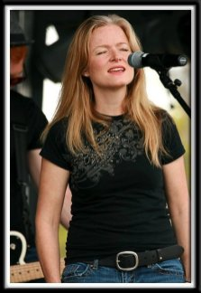 Kristi singing at the Dragon Boat Festival