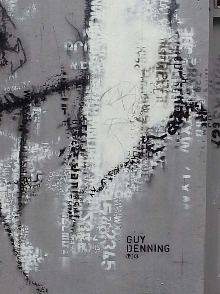 Boy up close made of words and letters