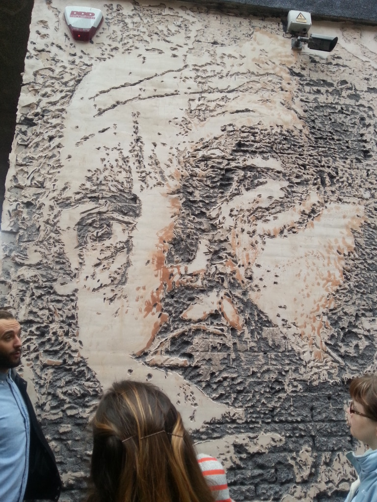 Plaster on a wall, carved with a jackhammer