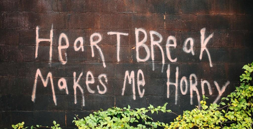 Graffiti on a wall about heartbreak