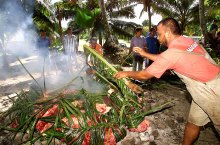 Tuna and meat has been cooked in traditional Fijian Lovo cooking methods