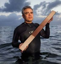 Paleoceanographer James Zachos holds a replica of a sediment core that shows an abrupt change in the Atlantic Ocean 56 million years ago, at the onset of the Paleocene-Eocene Thermal Maximum (PETM). White plankton shells vanished from the seafloor mud, shifting its color from white to red.