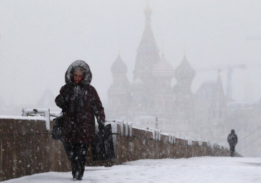 People walk during snowfall in Moscow1