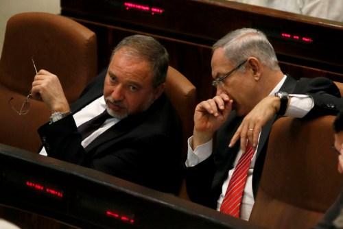 Israeli Prime Minister Benjamin Netanyahu speaks to Israeli Foriegn Minister Avigdor Lieberman