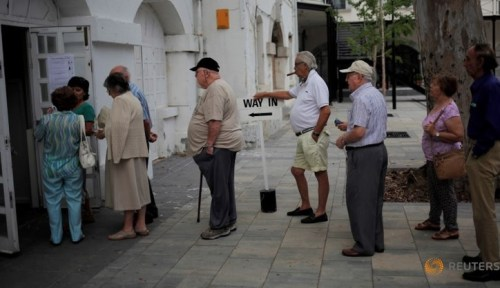 People wait in line to cast their ballots during the EU referendum at a polling station in the British overseas territory of Gibraltar, historically claimed by Spain.