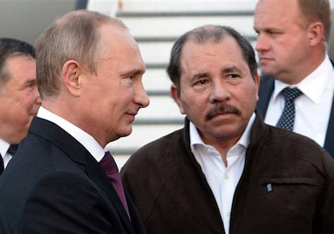 Russian President Vladimir Putin and Nicuraguan President Daniel Ortega attend a welcome ceremony at an airport in Managua, Nicaragua in 2014 / AP