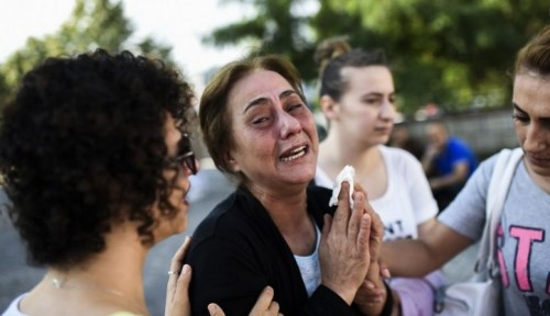 A mother of victims killed the day before in a suicide bombing and gun attack at Istanbul's airport, cries on Jun 29, 2016 in Istanbul.