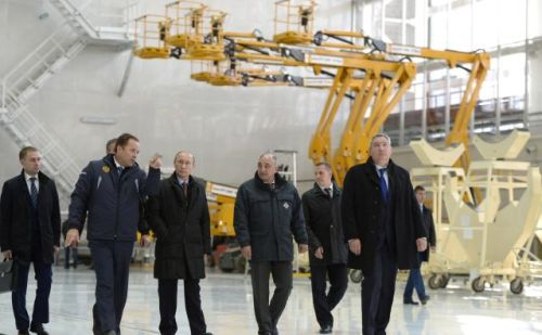 Vladimir Putin, center, and Dmitry Rogozin, far right, tour Russia's new Vostochny Cosmodrome in October, 2015.