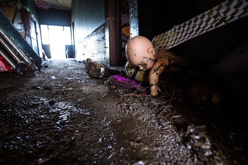 A soiled doll is washed up in a family home hit by the flood of the Mersey River in Latrobe, AustraliaHeath Holden/ Getty Images