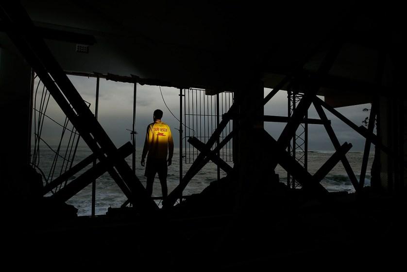 Coogee SLSC volunteer Julien Vincent poses amongst the damaged Coogee SLSCin Sydney, AustraliaBrendon Thorne/Getty Images