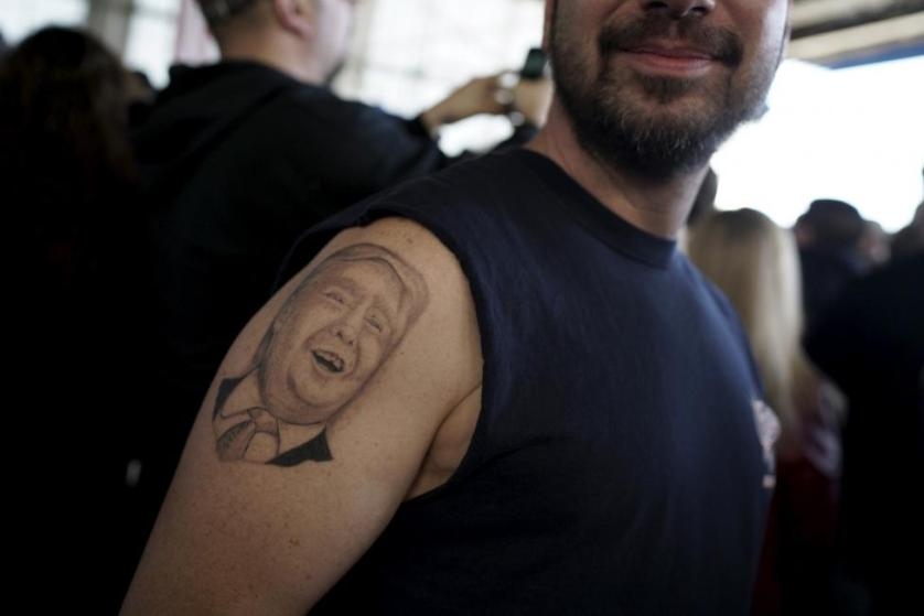 A supporter shows his tattoo before Donald Trump's campaign rally at Winner Aviation in Youngstown, Ohio March 14, 2016. REUTERS/Aaron P. Bernstein