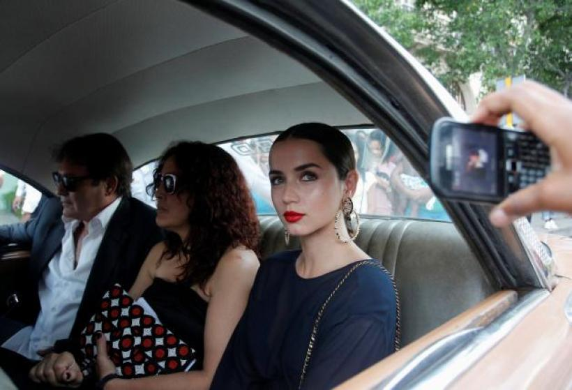 Actress Ana de Armas (R) rides in a vintage car along with others to attend a fashion show by Chanel, the first major fashion house to send models down the catwalk in Cuba, in Havana, May 3, 2016. REUTERS/Stringer