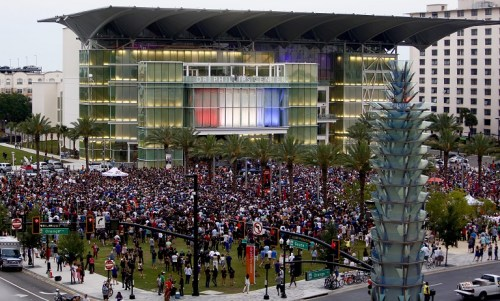 People gather at a vigil for Pulse nightclub victims at the Dr. Phillips Center in Orlando, Fla., Monday, June 13, 2016.