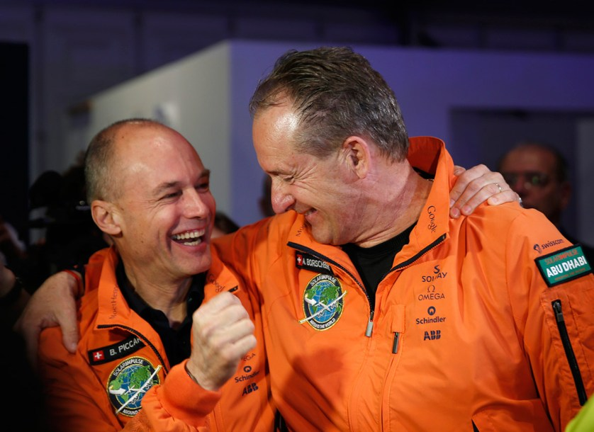 9 March 2015: Swiss pilots Bertrand Piccard and Andre Borschberg smile before boarding Solar Impulse 2, at Al Bateen airport in Abu Dhabi, at the start of an attempt to fly around the world in the solar-powered plane
