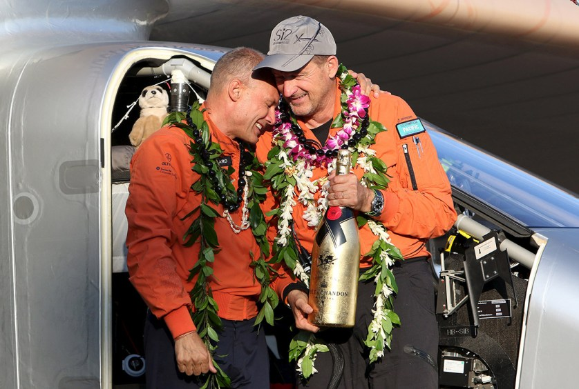 3 July 2015: Bertrand Piccard celebrates with Andre Borschberg after Solar Impulse 2, piloted by Borschberg, landed at Kalaeloa airport in Hawaii after flying non-stop from Nagoya, Japan, breaking a world record for the longest non-stop solo flight