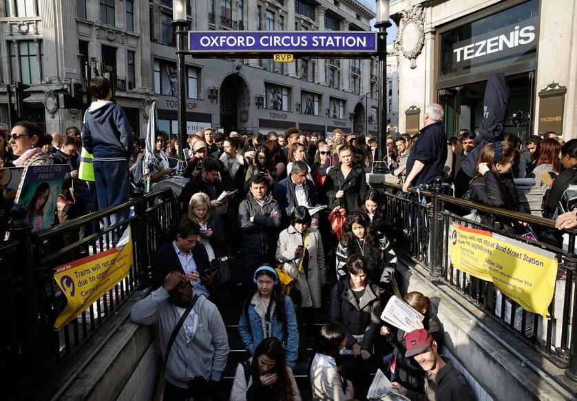 Commuters are held outside Oxford Circus tube station in London, United Kingdom, to regulate numbers