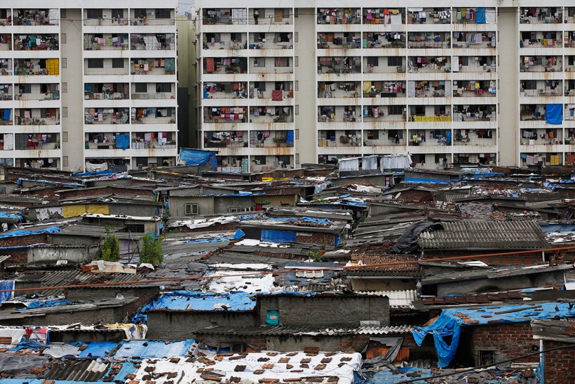 High rise residential buildings are seen behind a slum in Mumbai, India, on 20 July 2010