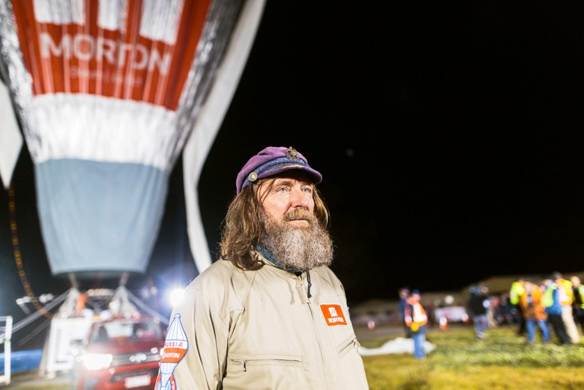 Russian adventurer Fedor Konyukhov watches his hot air balloon inflate