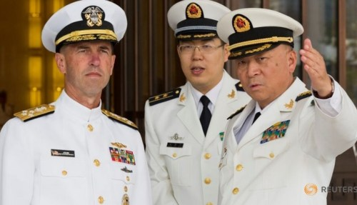 Commander of the Chinese navy, Admiral Wu Shengli points out the layout of the Chinese Navy Headquarters to visiting U.S. Chief of Naval Operations Admiral John Richardson (L) during a welcome ceremony held at the Chinese Navy Headquarters in Beijing, China, July 18, 2016.