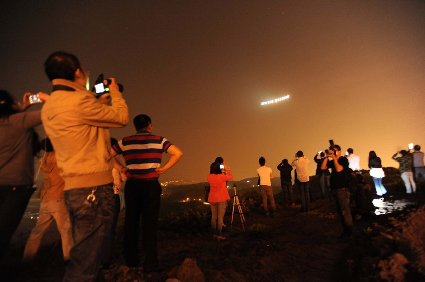 31 March 2015: People take photos as Solar Impulse 2 arrives at southern China's Chongqing Jiangbei International Airport after a 20-hour flight from Manadalay in Myanmar