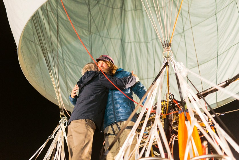 Russian adventurer Fedor Konyukhov hugs a member of his support staff before lift off