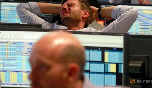 A trader from BGC, a global brokerage company in London's Canary Wharf financial centre reacts during trading June 24, 2016 after Britain voted to leave the European Union in the EU BREXIT referendum.
