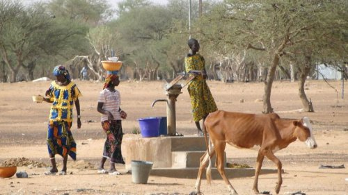Scene with Women at Village Well in Sahel Region, Burkina Faso.