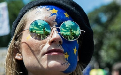 The Houses of Parliament are reflected in a woman's glasses as thousands of protesters joined a 'March for Europe' on July 2, to protest against Britain's vote to leave the European Union
