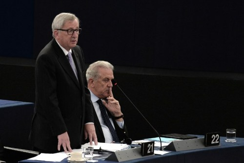 European Commission head Jean-Claude Juncker (L) speaks during a debate on the outcome of the EU summit on Jun 28-29 at the European Parliament in Strasbourg.