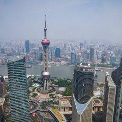 Шанхай может отказаться от английских надписей на дорожных знаках