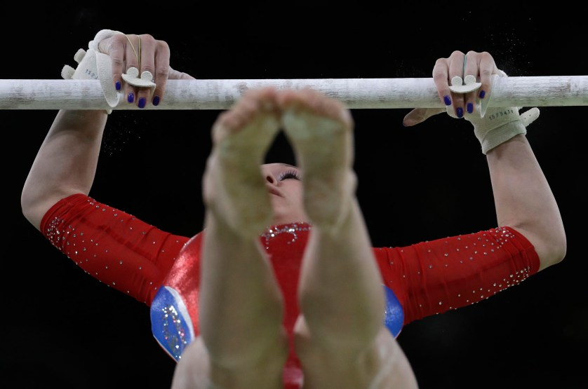 Russia's Daria Spiridonova performs on the uneven bars during the artistic gymnastics women's team final at the 2016 Summer Olympics in Rio de Janeiro, Brazil, Tuesday, Aug. 9, 2016. (AP Photo/Julio Cortez)