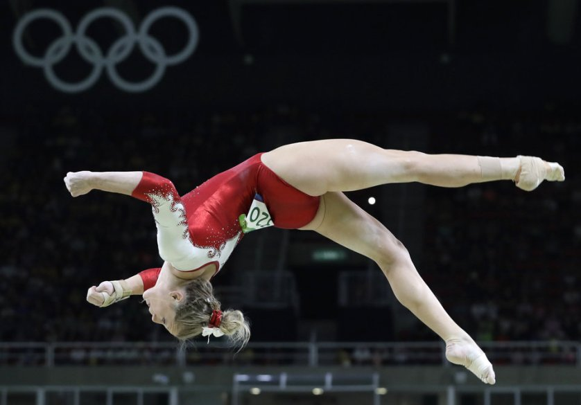 Canada's Brittany Rogers performs on the balance beam during the artistic gymnastics women's qualification at the 2016 Summer Olympics in Rio de Janeiro, Brazil, Sunday, Aug. 7, 2016. (AP Photo/Rebecca Blackwell)