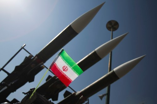 An Iranian flag is pictured next to missiles during a war exhibition to mark the anniversary of the Iran-Iraq war at Baharestan square near the Iranian Parliament in southern Tehran