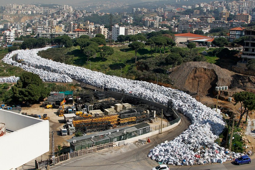 epa05600573 A general view of waste piled up along a street in the northern Beirut suburb of Al Fanar, Lebanon, 26 February 2016. The The ongoing waste crisis has hit another problem when the Lebanese cabinet reportedly cancelled plans to export the garbage to Russia. The problem began when the largest landfill in the country was closed.  EPA/NABIL MOUNZER