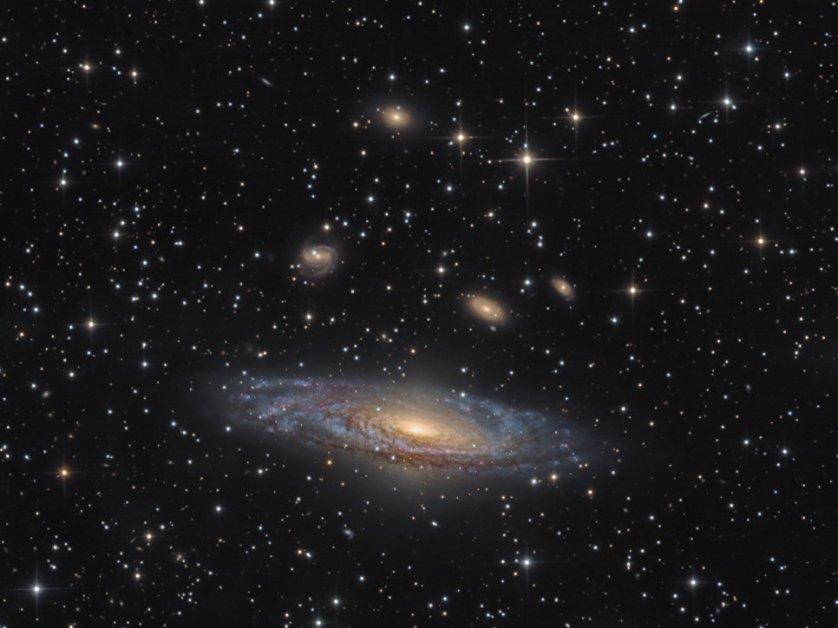"""Работа фотографа Bernard Miller """"NGC 7331 - спиральная галактика в созвездии Пегас"""" (NGC 7331 - The Deer Lick Group). Галактика NGC 7331 находится примерно в 40 миллионах световых лет от Земли, в созвездии Пегаса. Над крупнейшим скоплением звезд также можно увидеть галактики меньших размеров NGC 7335, NGC 7336, NGC 7337, NGC 7338 и NGC 7340, которые дрейфуют над ней."""